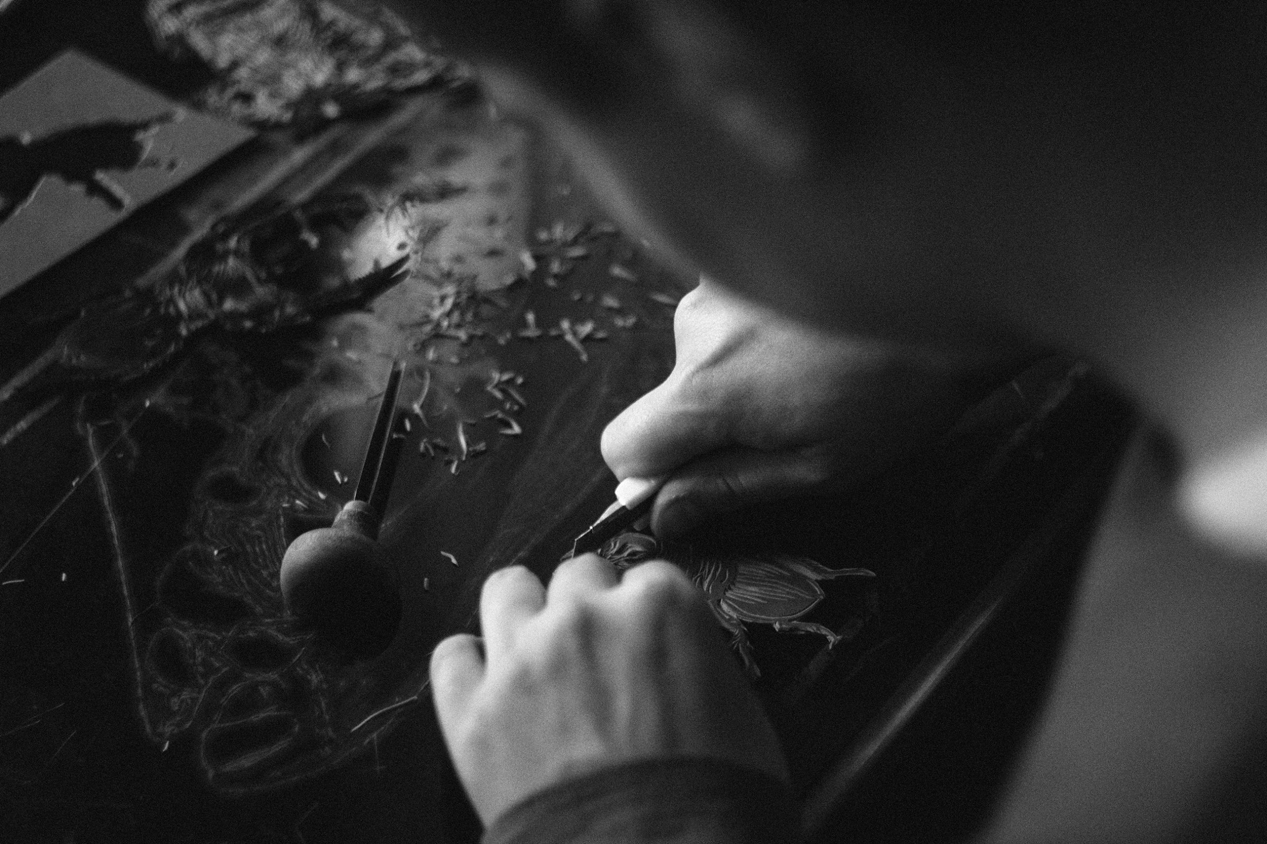 Black and white image of a man working leather.